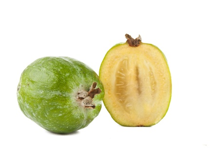 Cut feijoas isolated on white background photo