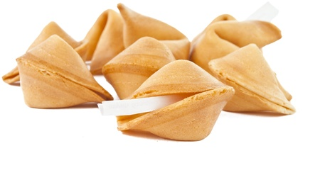 Fortune cookie with blank slip isolated on white background. photo
