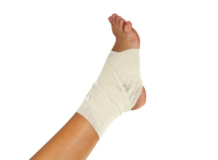 strapping: injured ankle with bandage on a white background Stock Photo