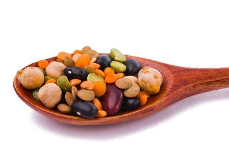 collection of beans, legumes, peas, lentils on wooden spoons isolated on white photo