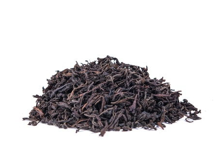 theine: Black tea loose dried tea leaves, isolated