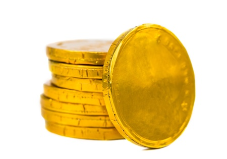 Gold coins isolated on white background photo