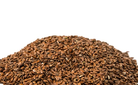 brown flax seed  isolated on white photo