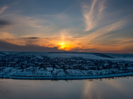 Beautiful winter sunset landscape on a hill photo