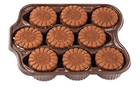 Chocolate cream cookies isolated on white photo