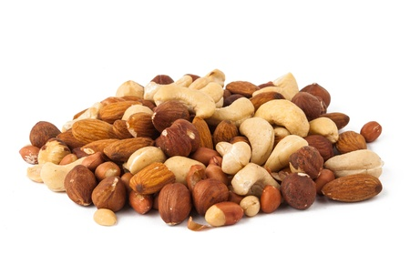 whole pecans: background of mixed nuts - hazelnuts, walnuts, almonds, pine nuts Stock Photo