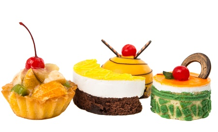 cakes with fruit isolated on white background photo