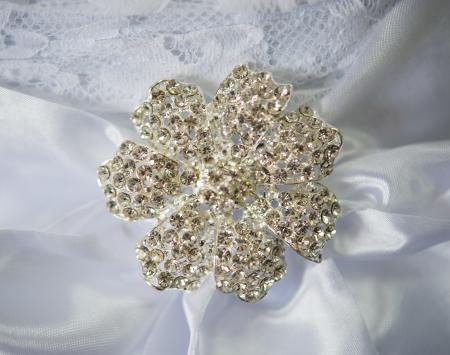 broach: Wedding dress detail with jeweled broach