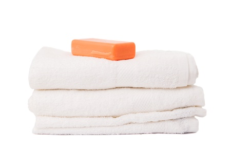 bathtime: soap and towels on white background