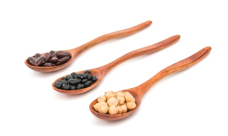 gr: pulses in a wooden spoon isolated on a white background Stock Photo