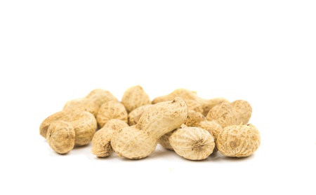Close-up few peanuts isolated on a white background.