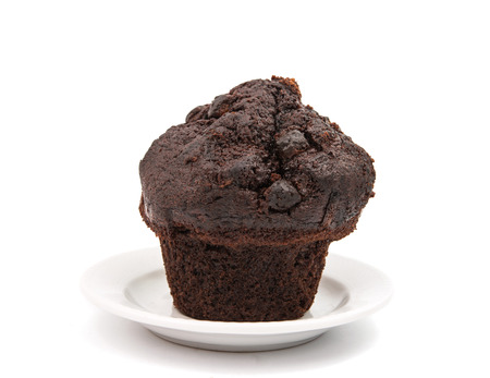 goods: chocolate muffin isolated on white background, very sweet
