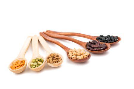 gr: pulses in a wooden spoon isolated on a white