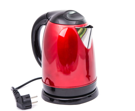 red teapot isolated on a white background photo