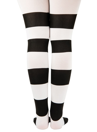 tights in black and white stripes on the legs girls isolated on white background photo