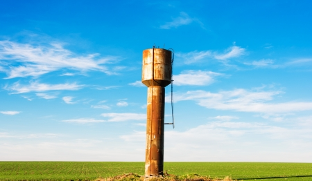 pressurized: old pressurized water tower of blue sky