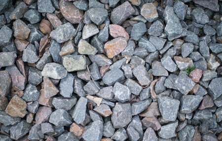 macadam: The carpet of crushed granite as background or texture. Stock Photo