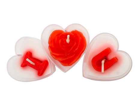 candles for Valentine's Day isolated on white background photo