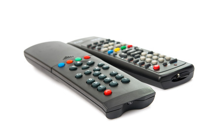 changing channels: TV remote isolated on white background