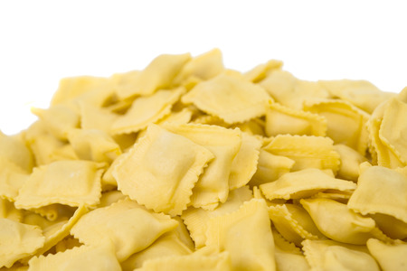 raviolo: Ravioli pasta squares isolated over white . Stock Photo