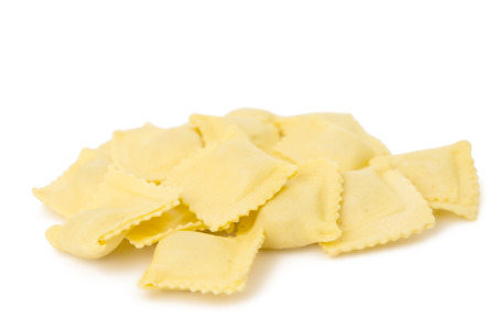 raviolo: Ravioli pasta squares isolated over white =.
