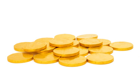 christmas profits: gold coins on a white background