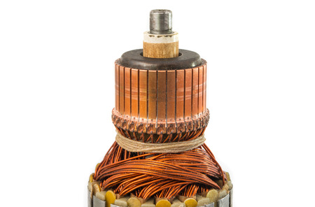 electromagnetism: Copper Coils inside Electric Motor on a white background Stock Photo
