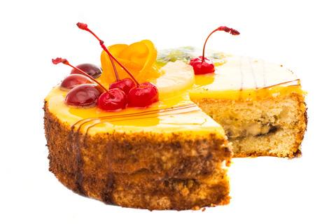 cake with fruit isolated on white background photo