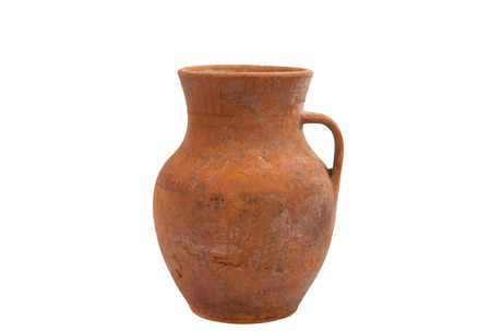 old clay jug on a white background