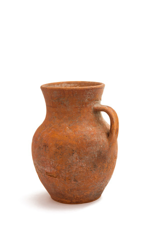 old clay jug on a white background photo