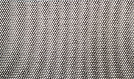 reticular: gray fishnet cloth material fragment as a texture background Stock Photo