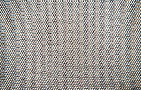 meshed: gray fishnet cloth material fragment as a texture background Stock Photo