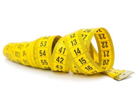 tapeline: yellow measuring tape on white background