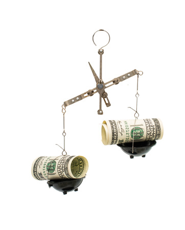 dollars on the scales on a white background photo