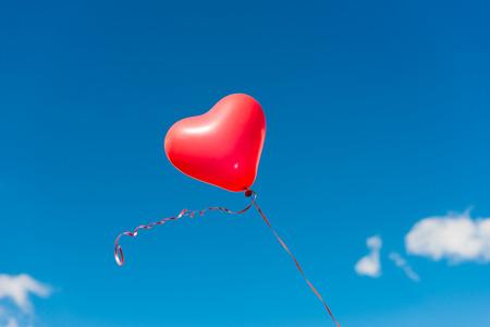 heart balloon: Valentine heart balloon against blue sky background