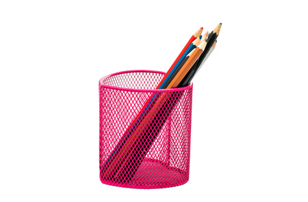 pencils in a pink basket on a white background photo
