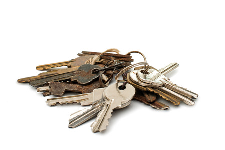 a bunch of old keys on white background photo