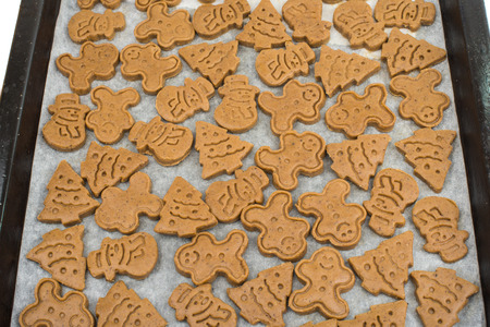 Gingerbread dough for Christmas cookies and cookie cutters. photo