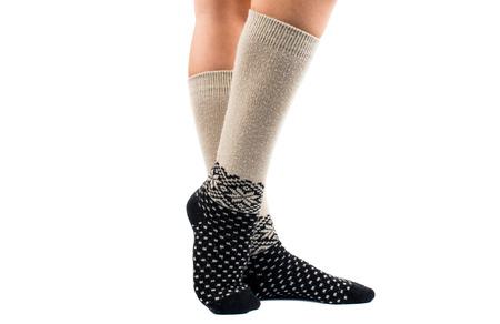 long feet: long socks on his feet on a white background