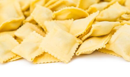 raviolo: Ravioli pasta squares isolated over white background. Stock Photo