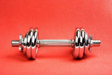 kilos: dumbbell on the mat for fitness Stock Photo