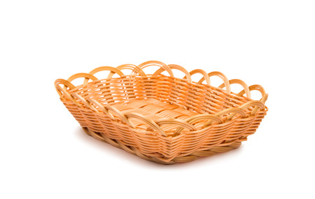 Empty wooden fruit or bread basket on white background photo