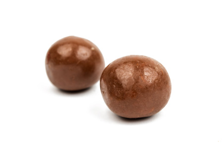 dragee: Dark brown dragee, in chocolate covered.