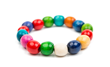 ancient sexy: colored wooden beads on a white background