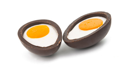sectioned: chocolate eggs on a white background Stock Photo