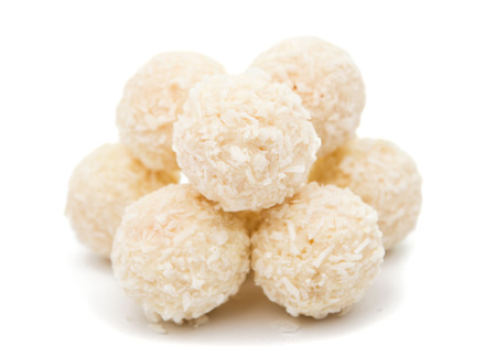 White Chocolate Candy With Coconut Topping On White Background