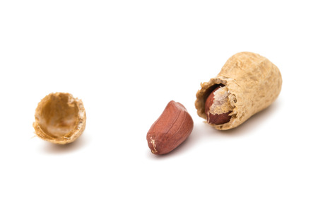 hard core: Peanuts on a white background