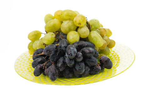white zinfandel: grapes in a plate on a white background