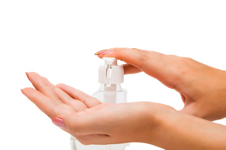 sudsy: Womens hands with soap on a white background