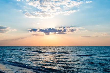 sunset clouds: Sunrise on the sea Stock Photo